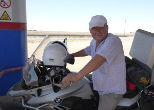 The petrol station owner was so pleased to have sat on Anne's bike, he gave her a big hug and a kiss