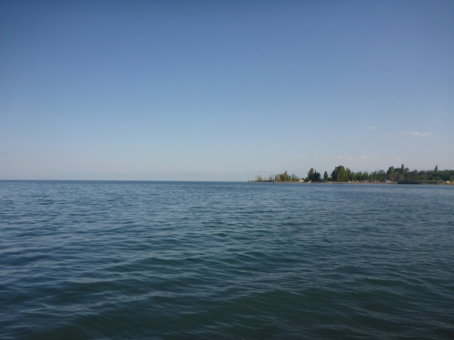 Issyk-Kul lake, Kyrgyzstan, with the snow capped mountains in the background