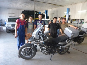 Our friendly team of mechanics who helped us adjust the tension our chains.