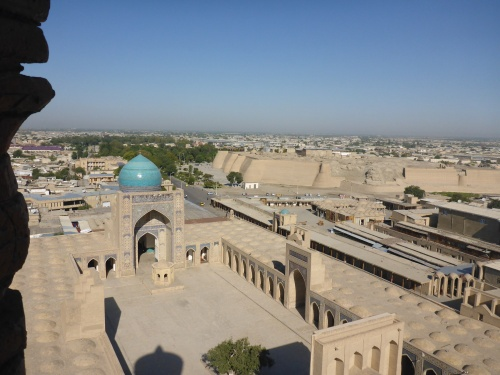 Emir Alim Khan madrassah, Poi-Kalon ensemble, Bukhara, Uzbekistan and view towards the citadel