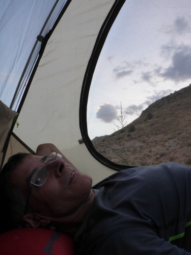 Enjoying watching the night fall from the safety and comfort of our tent, outside Dor Badam, Iran