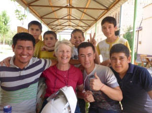 Our Uzbek friends after our amazing lunch stop in Uchqorghan - Abduvohid on my right and Mohamid on my left