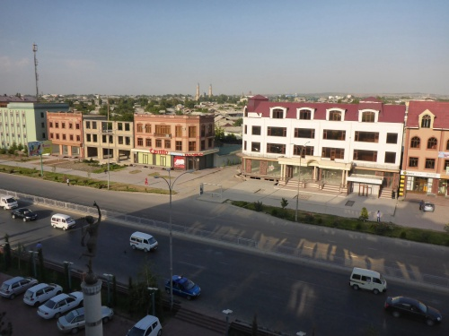 The clean, new facades in front of the real Andijan behind