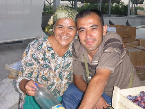 This vendor and her son were so sweet - I loved her eyes and gold teeth too. Chorsu market, Toshkent, Uzbekistan
