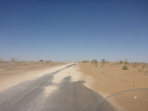 Big potholes and sand drifts on the way to Khiva