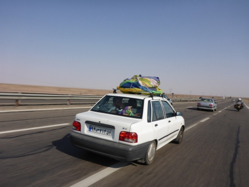 Friendly waves but I do wish the drivers didn't cut in front of us that way - on our way to Kashan, Iran