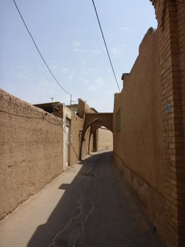 Not that white door!!  Our hotel entrance is just past the archway.  Kashan, Iran