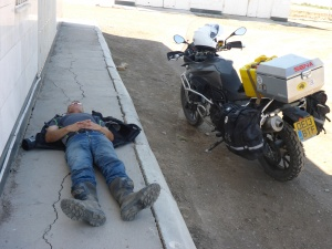 Anthony can take his nap anywhere - here at a petrol station in Turkmenistan