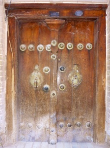 Traditional door with male and female knockers, Iran