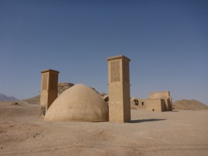 Wind towers above a water reservoir near the Towers of Silence, Yazd, Iran