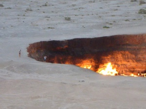 The 2 men show the scale of the Dervaza crater, Turkmenistan