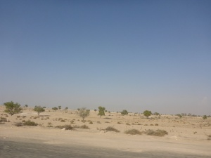 Riding around the edge of Dubai to get to Touratech