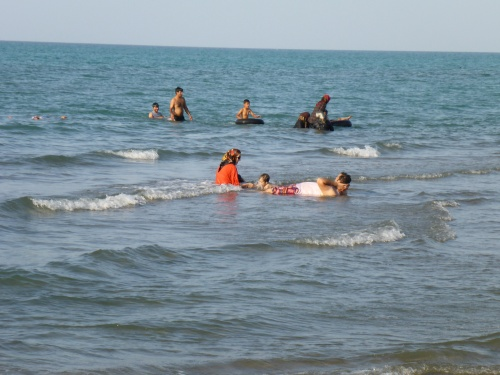 The guys are enjoying the cooling sea though... - Nur, Iran