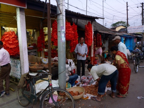 Seller of flowers, offerings, and oil lamps for Diwali in Guwahati