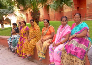 Indian ladies resting outside the Red Fort, Agra, India