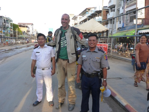 Ha ha, you me the world look normal until I see photos and people look tiny! (Said Dave on seeing this photo of him taken with Myanmar border officials)