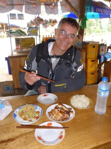 Enjoying our roadside breakfast by the Meekong, Laos