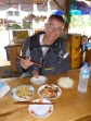 Enjoying our roadside breakfast by the Meekong, Laos