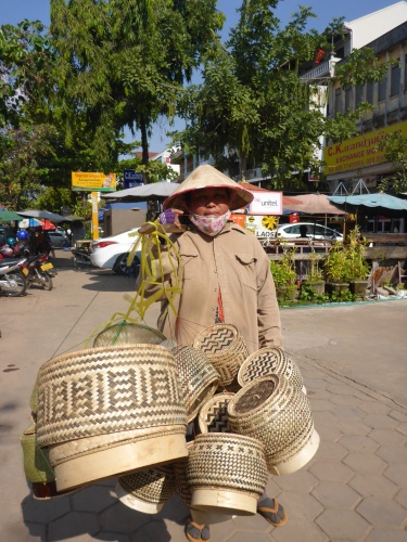 Rice basket seller in Vientiane, Laos