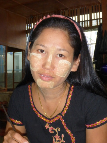 Myanmar lady with thanaka cream for its cosmetic and sunburn protection properties