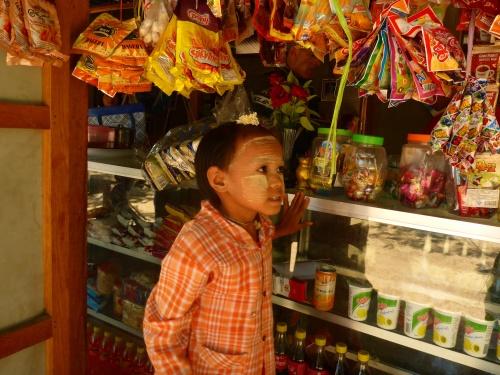Myanmar girl carefully choosing her candy