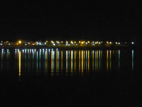 Lights of Thailand seen across the Mekong from Vientiane, Laos