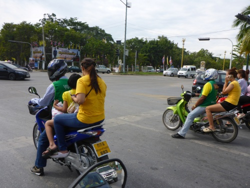 Yellow t-shirts worn by moped-taxi passengers, Ayutthaya, Thailand