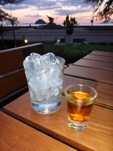 Anne's first scotch in months, Pak Meng beach, Thailand