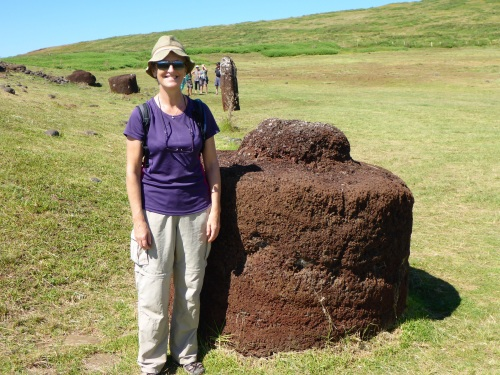 Anne next to a pukao or topknot.  The column in the background was a feminine statue with 2 heads, used as a funerary pillar