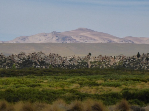 Heading towards Copahue, the rock formations are amazing - this is not a rock wall in the foreground but a long crest