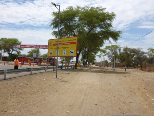 Special free lane for motorcyclists at a Peruvian road toll - they are all different