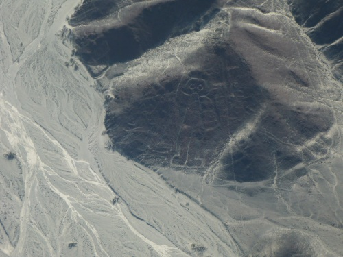 The Austronaut geoglyph on the hillside rather than the valley floor.