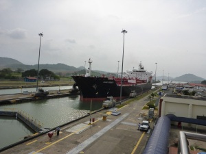 Condensate tanker being guided by trucks along the lock, Panama Canal