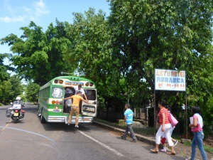 These buses barely stop to let passengers on and off in El Savador