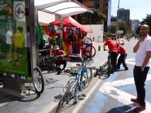 Good use of a bus stop for bicycle tyre repair on Sunday, Bogota, Colombia