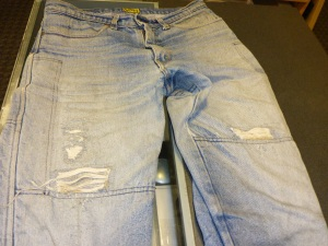 Anthony's patched up Dragon Jeans are ready to be given away
