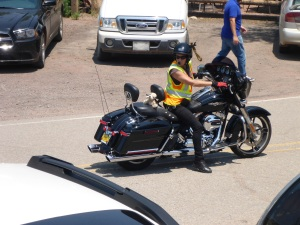 Love her pigtails attached to her helmet -  marshall for the 86 Harleys arriving at the tavern