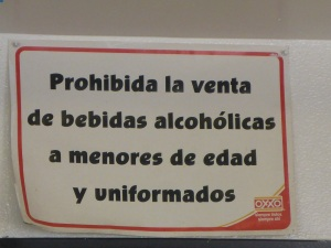 Sign in a roadside cafe in Mexico - no alcohol for minors or people in uniform