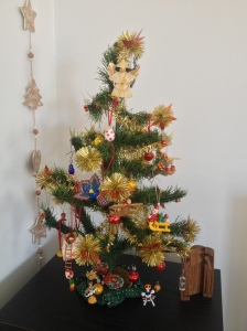 Our beloved 35 year old Christmas tree with miniature mementoes of our travels