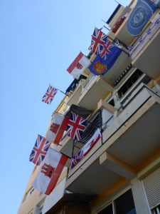 British, Gibraltar and Chelsea FC flags.