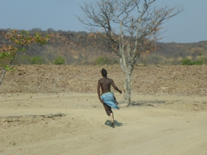 Himba teenager showing us the way across the creek